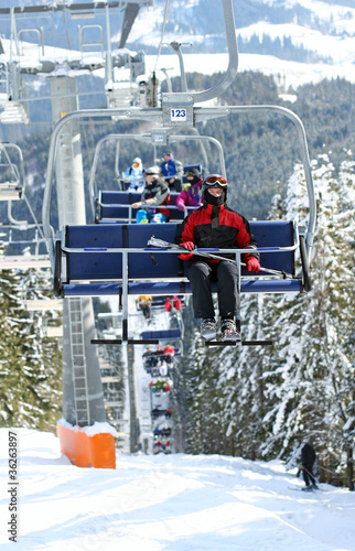 Skiers in chairlift