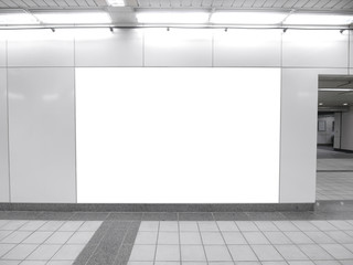 Blank billboard in underground passage