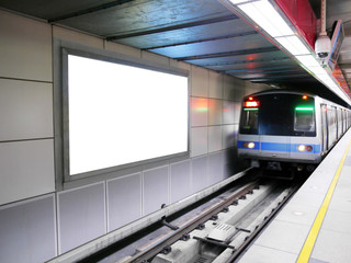 Blank billboard in subway station