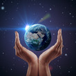 Hand holding earth. Night background, shining