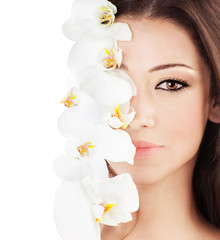 Closeup on beautiful face with orchid flower