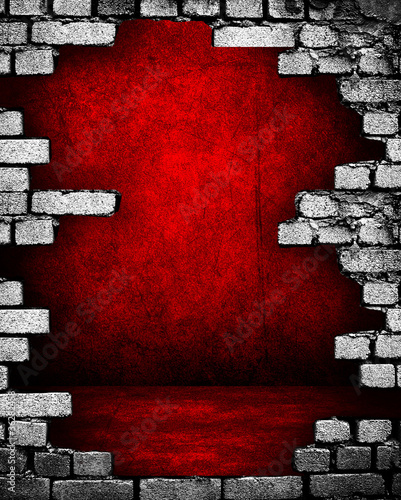 broken brick wall with red interior