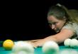 woman plays russian billiards