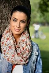 Spring portrait of pretty girl in park smiling