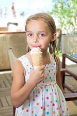 Cute little girl eating icecream