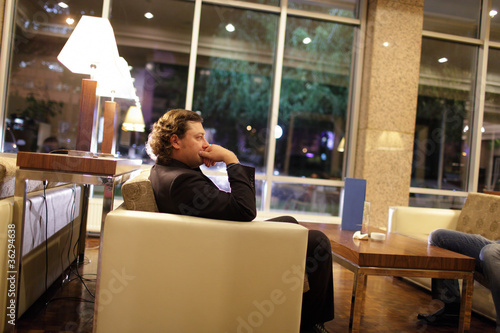 Man relaxing in hotel lobby