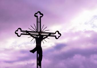 Cross silhouette against purple sky