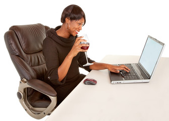 African American Woman Texting to Someone While Drinking Wine