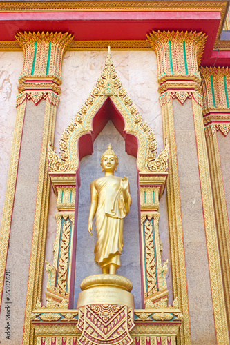 golden buddha in Wat Chalong
