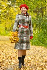 Happy senior woman  in autumn