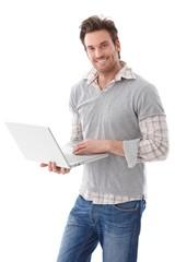 Happy man using laptop