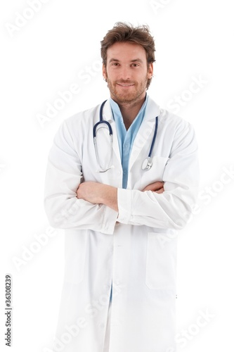 Handsome doctor standing arms crossed smiling