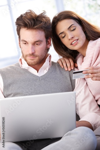 Young couple shopping on internet