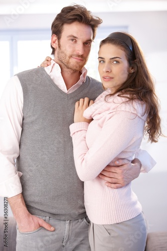Attractive couple hugging