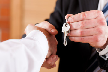Business Handshake with giving keys