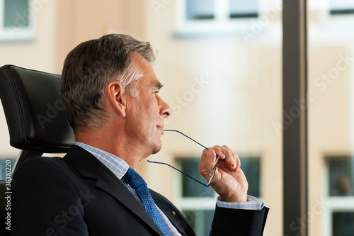 Business - Boss contemplating in his office