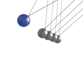 newton cradle in motion. leadership concept