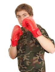 young man in red boxing gloves, white background.