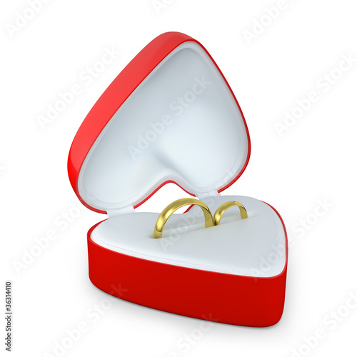 Pair of wedding rings in a heart shaped box