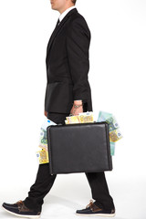 businessman carrying suitcase full of money