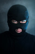 Burglar in black balaclava at night