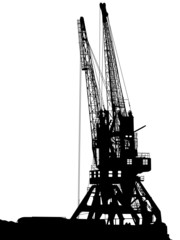 Silhouettes of two port cranes