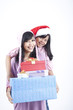 Happy mother and daughter with gift boxes
