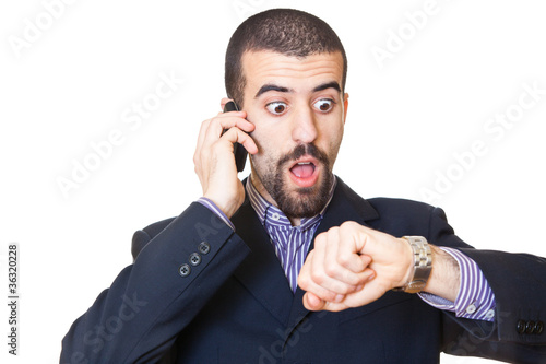 Busy Businessman Talking on Mobile While Looking at Time