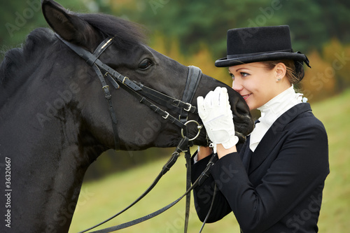 horsewoman jockey in uniform with horse - 36320667