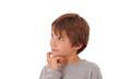 Schwere Entscheidung - Junge, Kind grübelt mit Blick nach oben