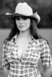 Portriat of a beautiful cowgirl