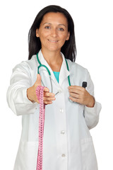 Adorable doctor offering a tape measure