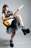 Cosplay girl in black dress with guitar poster