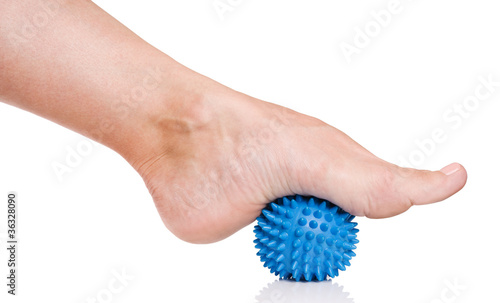 Woman's foot with massage ball
