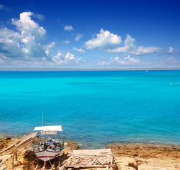 Formentera Es Ram beach with traditional boat