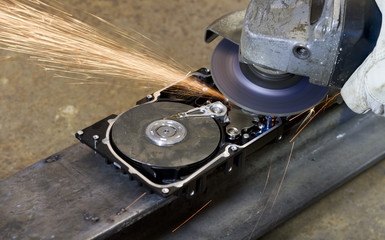 angular grinder on open hard drive