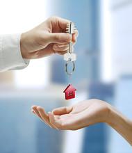 """Постер, картина, фотообои """"Man is handing a house key to a woman"""""""