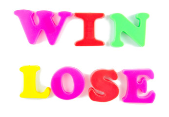 win and lose written in fridge magnets