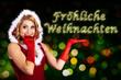 Weihnachtsfrau zeigt Fröhliche Weihnachten