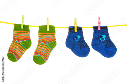 Children's bright socks on line isolated on white