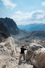 Hiker and view of Picos d'Europa, Asturias, Spain