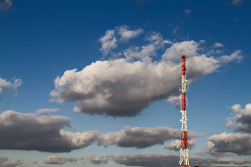telecommunication tower, clouds and blue sky