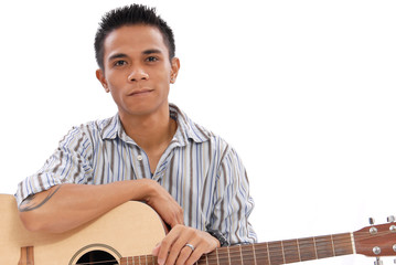 Guy Holding an Acoustic Guitar