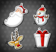 Labels of Santa Claus, reindeer, snowman, and christmas gift