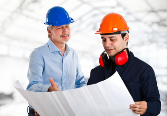 Engineer and a worker in a construction site
