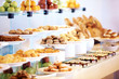 Catering buffet food in restaurant with dessert and fresh fruits