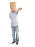 pointing man with sad ecological paper bag on head, full length