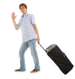 teenage man with suitcase waving hello, full length