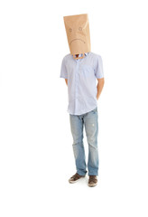 young man with sad ecological paper bag on head, full length