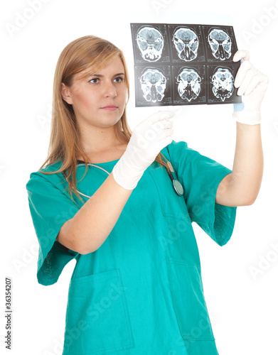 concentrated female doctor looking at tomography brain.